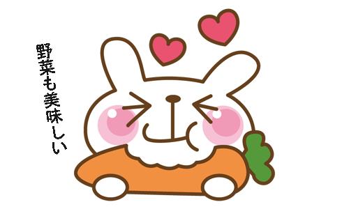 ウサギがニンジンを食べながら野菜も美味しいと言っているイラスト